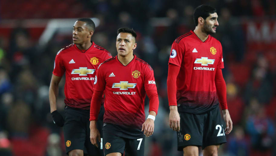MANCHESTER, ENGLAND - NOVEMBER 24:  Alexis Sanchez, Anthony Martial and Marouane Fellaini of Manchester United look dejected after the Premier League match between Manchester United and Crystal Palace at Old Trafford on November 24, 2018 in Manchester, United Kingdom.  (Photo by Alex Livesey/Getty Images)