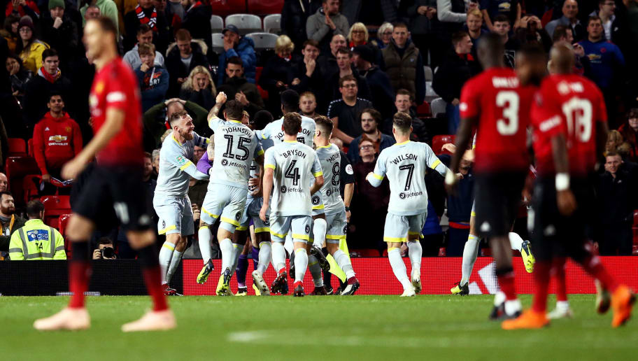 MANCHESTER, ENGLAND - SEPTEMBER 25:  The Derby County team celebrate victory after a penalty shoot out in the Carabao Cup Third Round match between Manchester United and Derby County at Old Trafford on September 25, 2018 in Manchester, England.  (Photo by Jan Kruger/Getty Images)