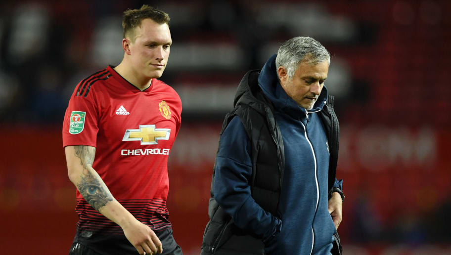 MANCHESTER, ENGLAND - SEPTEMBER 25:  Phil Jones of Manchester United looks dejected after missing his team's eighth penalty, meaning Derby County win the match on penalties during the Carabao Cup Third Round match between Manchester United and Derby County at Old Trafford on September 25, 2018 in Manchester, England.  (Photo by Gareth Copley/Getty Images)