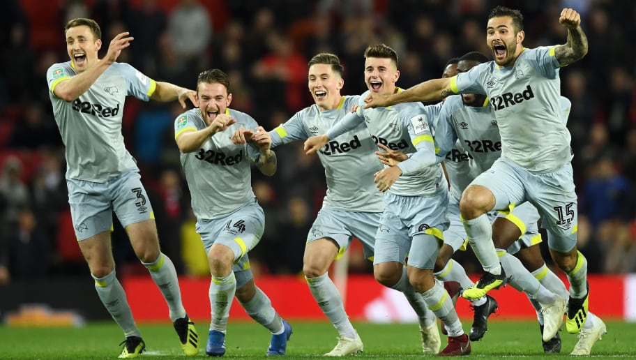 MANCHESTER, ENGLAND - SEPTEMBER 25: The Derby County team celebrate victory after a penalty shoot out in the Carabao Cup Third Round match between Manchester United and Derby County at Old Trafford on September 25, 2018 in Manchester, England.  (Photo by Gareth Copley/Getty Images)