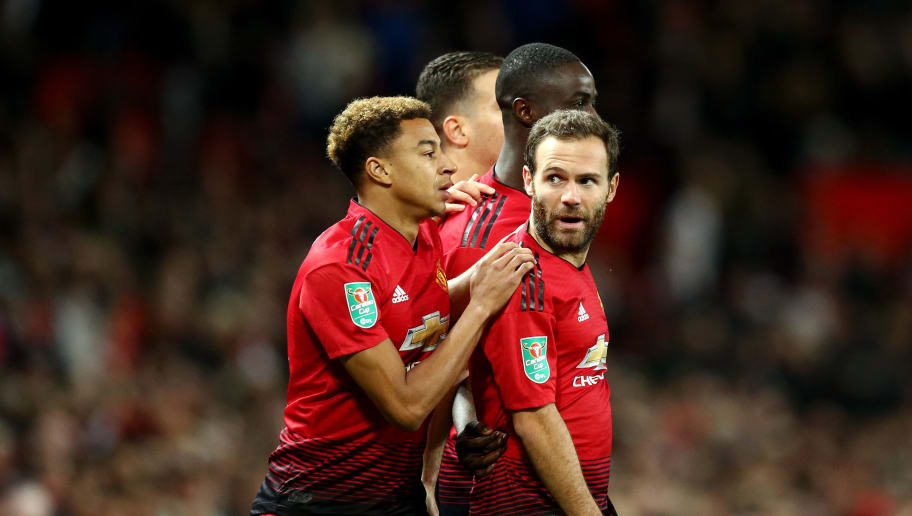 MANCHESTER, ENGLAND - SEPTEMBER 25:  Juan Mata of Manchester United celebrates with teammate Jesse Lingard after scoring his team's first goal during the Carabao Cup Third Round match between Manchester United and Derby County at Old Trafford on September 25, 2018 in Manchester, England.  (Photo by Jan Kruger/Getty Images)