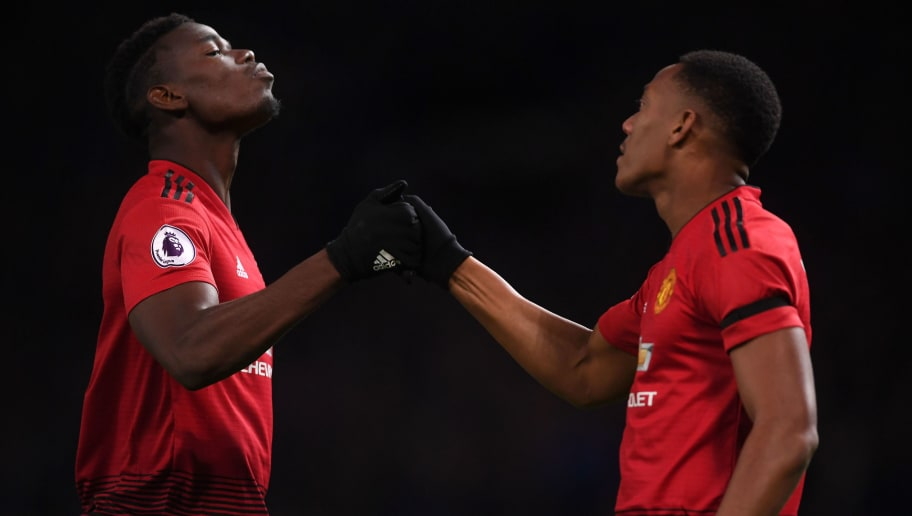 MANCHESTER, ENGLAND - OCTOBER 28:  Paul Pogba of Manchester United congratulates Anthony Martial on scoring the second goal during the Premier League match between Manchester United and Everton FC at Old Trafford on October 28, 2018 in Manchester, United Kingdom. (Photo by Laurence Griffiths/Getty Images)