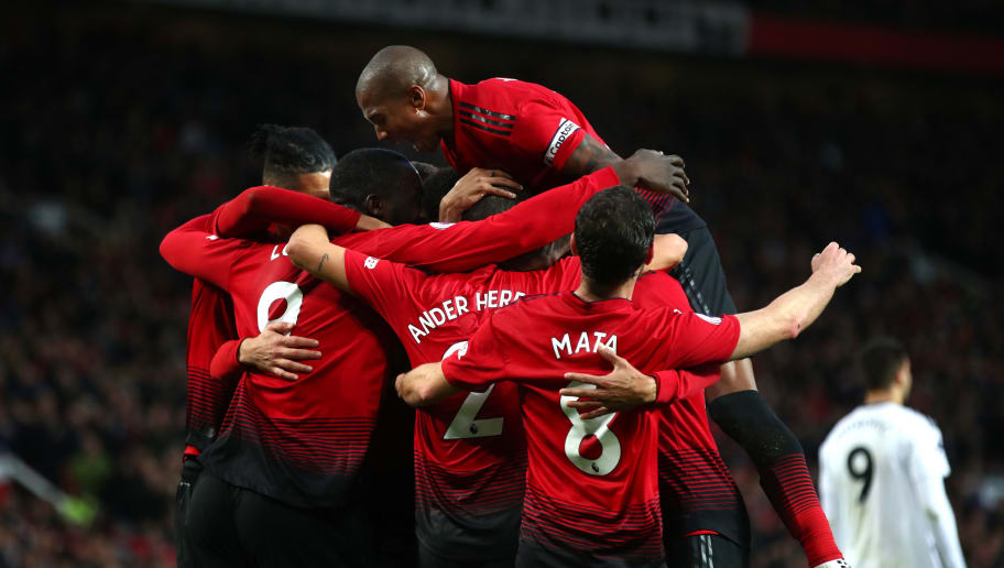 MANCHESTER, ENGLAND - DECEMBER 08:  Romelu Lukaku of Manchester United celebrates with teammates after scoring his team's third goal during the Premier League match between Manchester United and Fulham FC at Old Trafford on December 8, 2018 in Manchester, United Kingdom.  (Photo by Clive Brunskill/Getty Images)