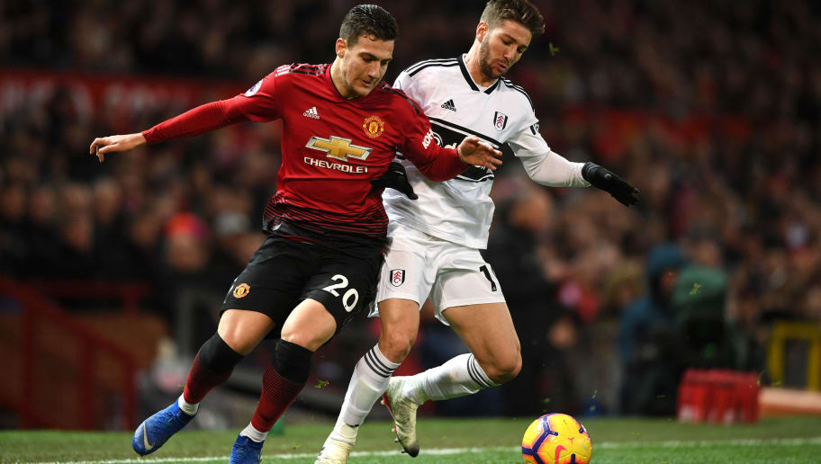MANCHESTER, ENGLAND - DECEMBER 08: Diogo Dalot of Manchester United is challenged by Luciano Vietto of Fulham during the Premier League match between Manchester United and Fulham FC at Old Trafford on December 8, 2018 in Manchester, United Kingdom.  (Photo by Gareth Copley/Getty Images)