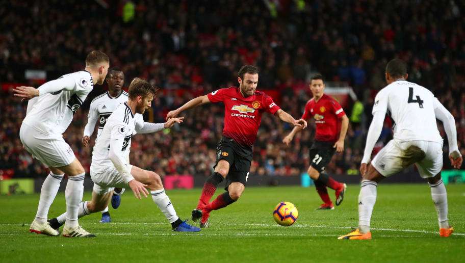 MANCHESTER, ENGLAND - DECEMBER 08: Juan Mata of Manchester United is challenged by the Fulham defence during the Premier League match between Manchester United and Fulham FC at Old Trafford on December 8, 2018 in Manchester, United Kingdom.  (Photo by Clive Brunskill/Getty Images)