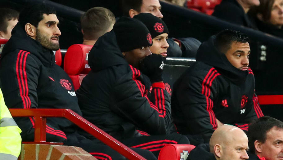 MANCHESTER, ENGLAND - DECEMBER 08: Paul Pogba of Manchester United looks on from the bench during the Premier League match between Manchester United and Fulham FC at Old Trafford on December 8, 2018 in Manchester, United Kingdom. (Photo by Robbie Jay Barratt - AMA/Getty Images)