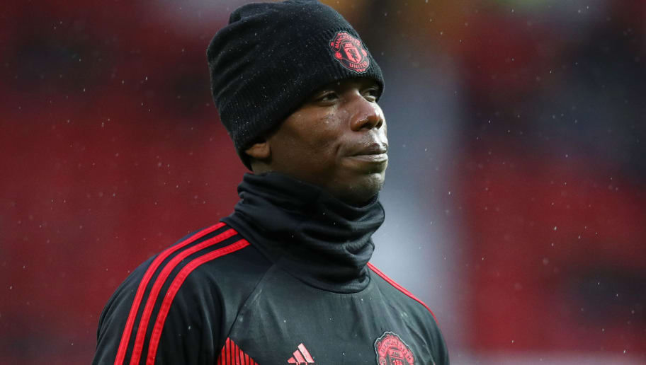 MANCHESTER, ENGLAND - DECEMBER 08:  Paul Pogba of Manchester United looks on prior to the Premier League match between Manchester United and Fulham FC at Old Trafford on December 8, 2018 in Manchester, United Kingdom.  (Photo by Clive Brunskill/Getty Images)