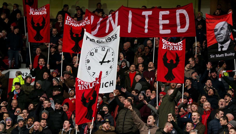 MANCHESTER, ENGLAND - FEBRUARY 03: Fans of Manchester United hold up banners in respect of the Munich disaster during the Premier League match between Manchester United and Huddersfield Town at Old Trafford on February 3, 2018 in Manchester, England. (Photo by Robbie Jay Barratt - AMA/Getty Images)