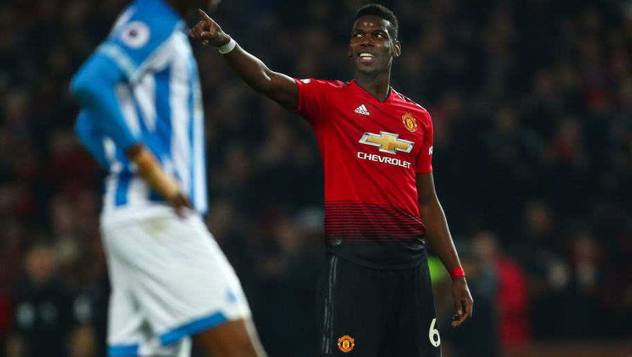 MANCHESTER, ENGLAND - DECEMBER 26: Paul Pogba of Manchester United celebrates after scoring a goal to make it 3-0 during the Premier League match between Manchester United and Huddersfield Town at Old Trafford on December 26, 2018 in Manchester, United Kingdom. (Photo by Robbie Jay Barratt - AMA/Getty Images)
