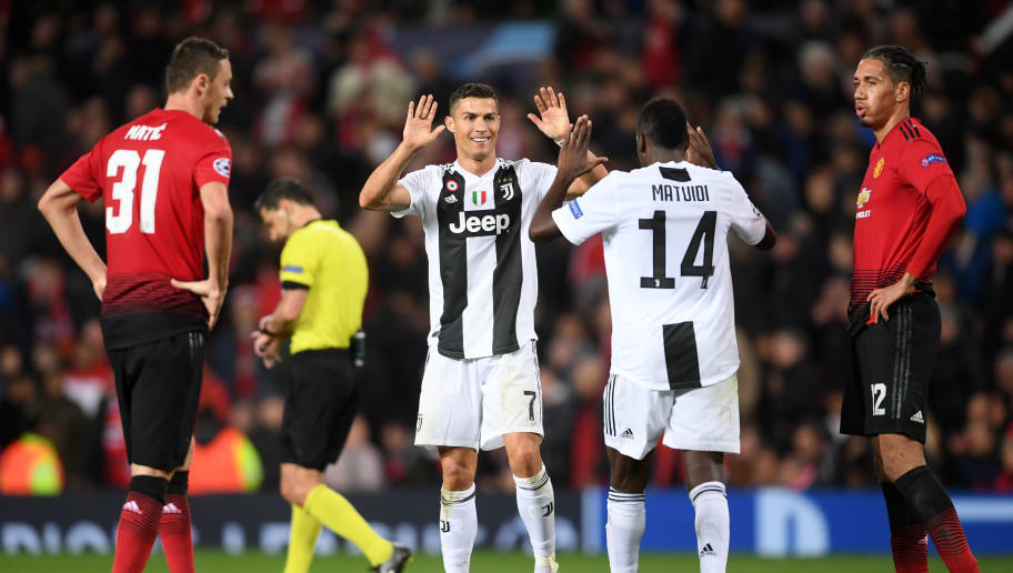MANCHESTER, ENGLAND - OCTOBER 23: Cristiano Ronaldo and Blaise Matuidi of Juventus celebrate in front of Nemanja Matic and Chris Smalling of Manchester United following their sides victory in the Group H match of the UEFA Champions League between Manchester United and Juventus at Old Trafford on October 23, 2018 in Manchester, United Kingdom. (Photo by Laurence Griffiths/Getty Images)