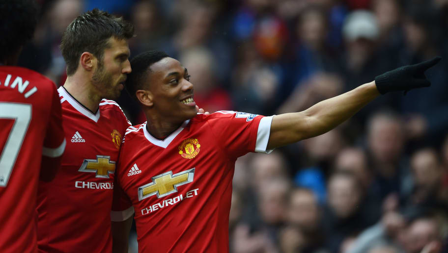 MANCHESTER, UNITED KINGDOM - MAY 01:  Anthony Martial of Manchester United celebrates scoring the opening goal with Michael Carrick (L) during the Barclays Premier League match between Manchester United and Leicester City at Old Trafford on May 1, 2016 in Manchester, England.  (Photo by Laurence Griffiths/Getty Images)