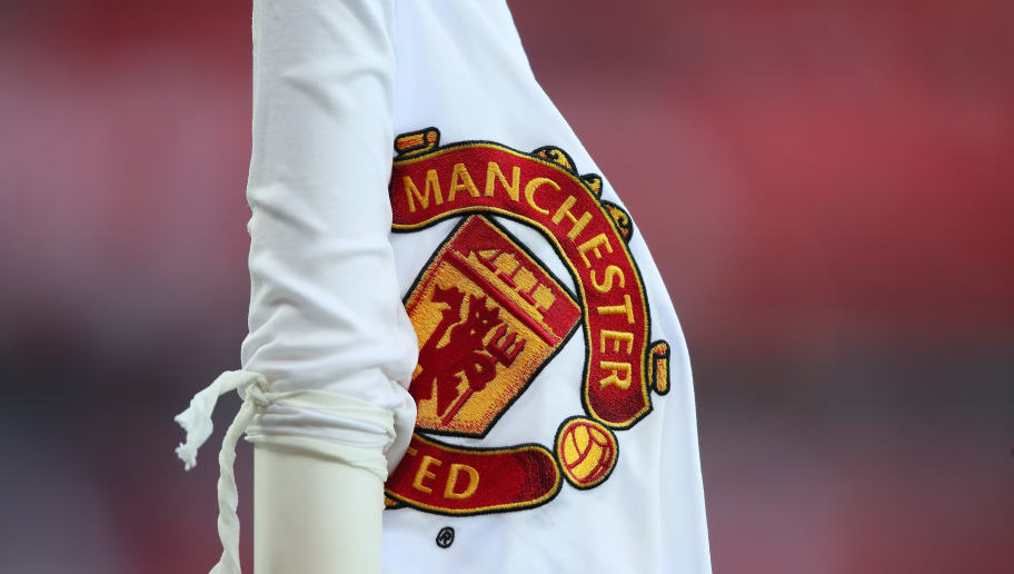 MANCHESTER, ENGLAND - AUGUST 10: The Manchester United badge on a corner flag during the Premier League match between Manchester United and Leicester City at Old Trafford on August 10, 2018 in Manchester, United Kingdom. (Photo by Matthew Ashton - AMA/Getty Images)