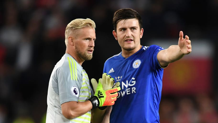 MANCHESTER, ENGLAND - AUGUST 10:  Kasper Schmeichel of Leicester City and Harry Maguire of Leicester City speak during the Premier League match between Manchester United and Leicester City at Old Trafford on August 10, 2018 in Manchester, United Kingdom.  (Photo by Michael Regan/Getty Images)
