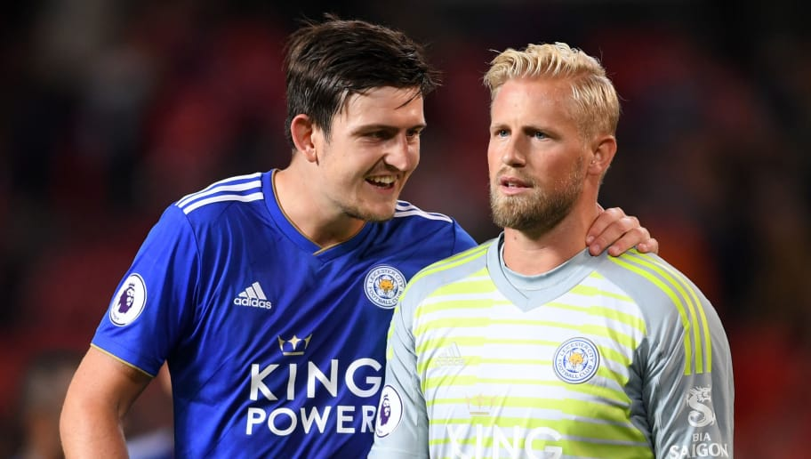 MANCHESTER, ENGLAND - AUGUST 10:  Harry Maguire of Leicester City embraces Kasper Schmeichel of Leicester City after the Premier League match between Manchester United and Leicester City at Old Trafford on August 10, 2018 in Manchester, United Kingdom.  (Photo by Laurence Griffiths/Getty Images)