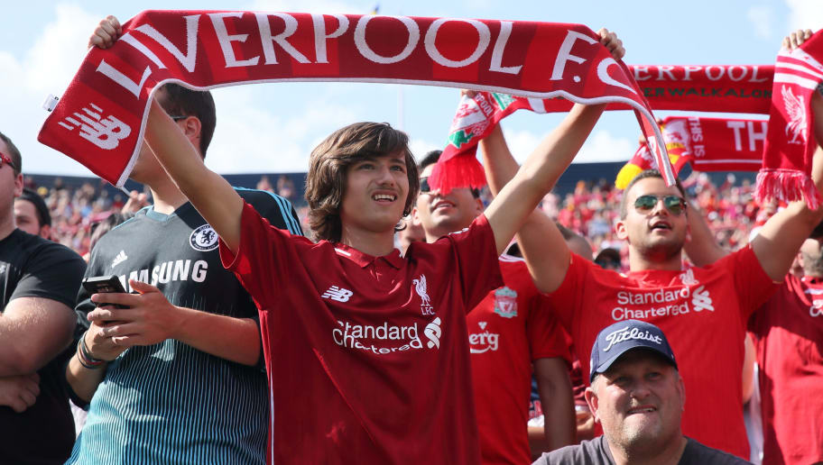 ANN ARBOR, MI - JULY 28: Fans of Liverpool hold up scarfs whilst singing You'll Never Walk Alone during the International Champions Cup 2018 match between Manchester Untied and Liverpool at Michigan Stadium on July 28, 2018 in Ann Arbor, Michigan. (Photo by Matthew Ashton - AMA/Getty Images)
