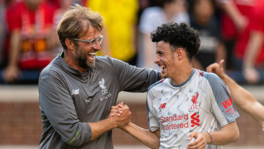 ANN ARBOR, MI - JULY 28: Head coach Jurgen Klopp celebrates with Curtis Jones #48 after Liverpool defeated Manchester United during second half of the International Champions Cup 2018 at Michigan Stadium on July 28, 2018 in Ann Arbor, Michigan. Liverpool defeated Manchester United 4-1. (Photo by Jason Miller/Getty Images)