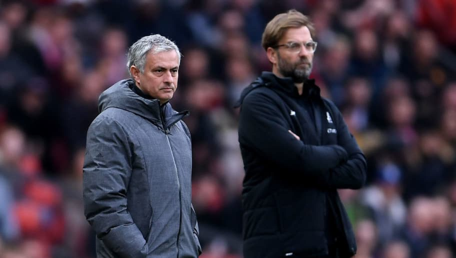 MANCHESTER, ENGLAND - MARCH 10:  Jose Mourinho, Manager of Manchester United and Jurgen Klopp, Manager of Liverpool look on during the Premier League match between Manchester United and Liverpool at Old Trafford on March 10, 2018 in Manchester, England.  (Photo by Laurence Griffiths/Getty Images)
