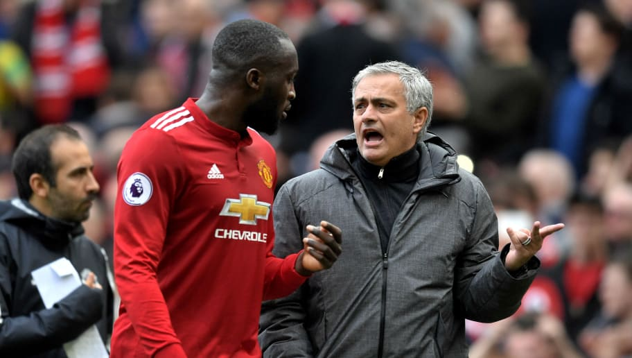 MANCHESTER, ENGLAND - MARCH 10:  Romelu Lukaku of Manchester United speaks with Jose Mourinho during the Premier League match between Manchester United and Liverpool at Old Trafford on March 10, 2018 in Manchester, England.  (Photo by Michael Regan/Getty Images)