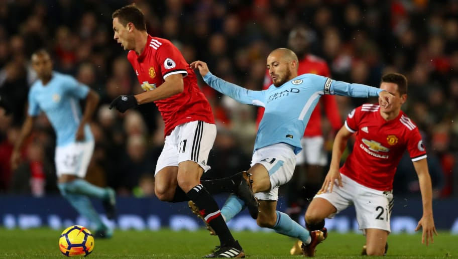 MANCHESTER, ENGLAND - DECEMBER 10:  Nemanja Matic of Manchester United is tackled by David Silva of Manchester City during the Premier League match between Manchester United and Manchester City at Old Trafford on December 10, 2017 in Manchester, England.  (Photo by Michael Steele/Getty Images)