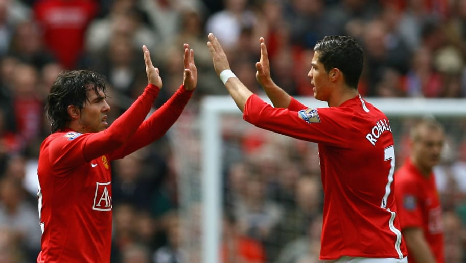 MANCHESTER, ENGLAND - MAY 10:  Cristiano Ronaldo of Manchester United congratulates team mate Carlos Tevez after he scored his team's second goal during the Barclays Premier League match between Manchester United and Manchester City at Old Trafford on May 10, 2009 in Manchester, England.  (Photo by Alex Livesey/Getty Images)