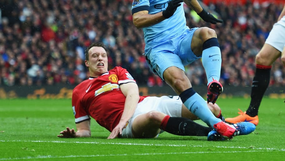 MANCHESTER, ENGLAND - APRIL 12:  Sergio Aguero of Manchester City is challenged by Phil Jones of Manchester United during the Barclays Premier League match between Manchester United and Manchester City at Old Trafford on April 12, 2015 in Manchester, England.  (Photo by Michael Regan/Getty Images)