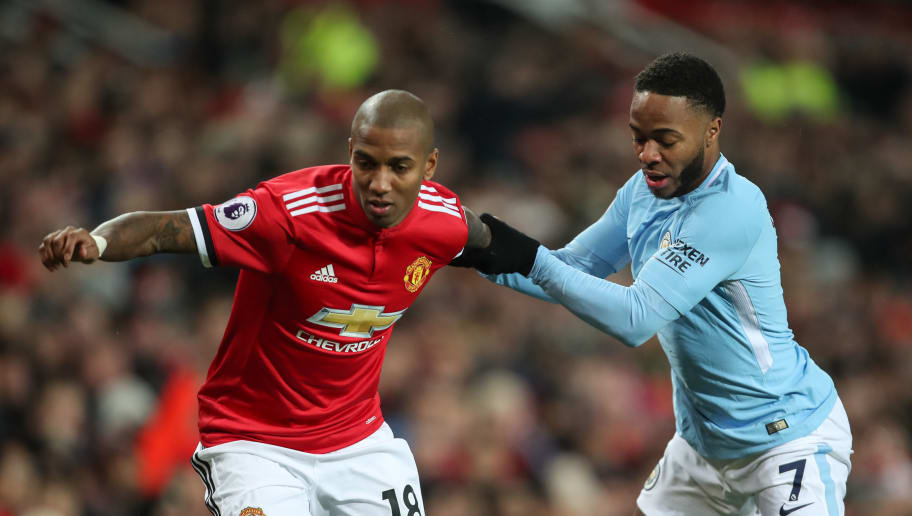 MANCHESTER, ENGLAND - DECEMBER 10: Ashley Young of Manchester United and Raheem Sterling of Manchester City during the Premier League match between Manchester United and Manchester City at Old Trafford on December 10, 2017 in Manchester, England. (Photo by Robbie Jay Barratt - AMA/Getty Images)