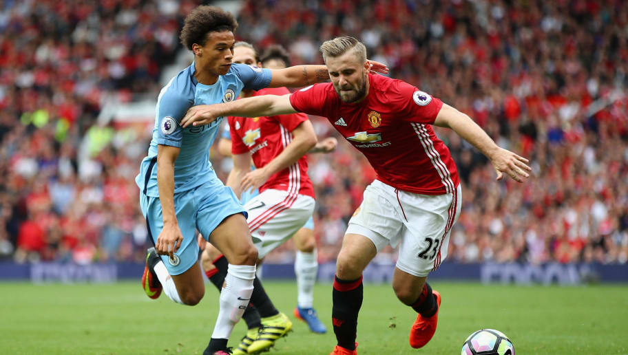 MANCHESTER, ENGLAND - SEPTEMBER 10:  Luke Shaw of Manchester United in action with Leroy Sane of  Manchester City during the Premier League match between Manchester United and Manchester City at Old Trafford on September 10, 2016 in Manchester, England.  (Photo by Clive Brunskill/Getty Images)