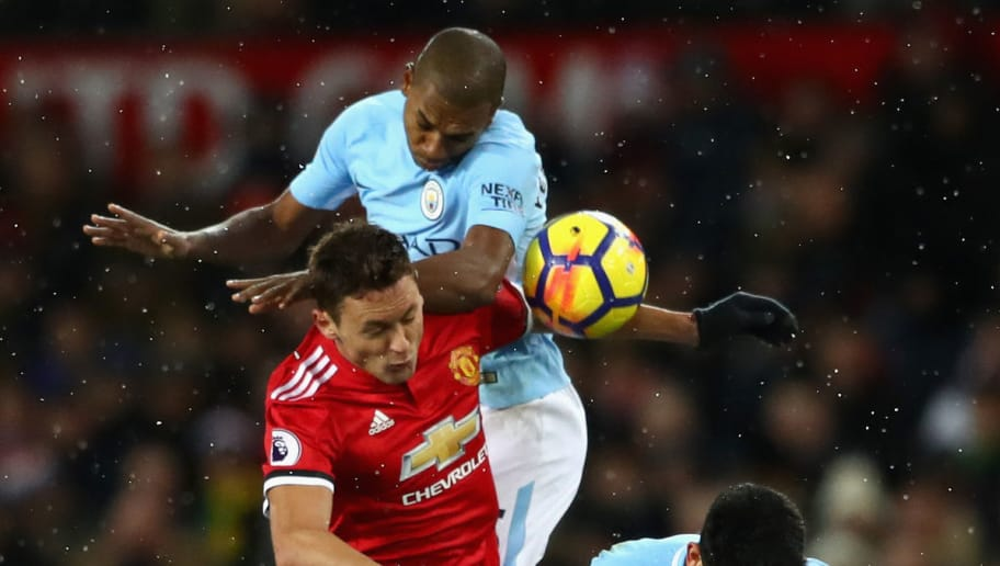 MANCHESTER, ENGLAND - DECEMBER 10:  Fernandinho of Manchester City and Ilkay Gundogan of Manchester City clash with Nemanja Matic of Manchester United during the Premier League match between Manchester United and Manchester City at Old Trafford on December 10, 2017 in Manchester, England.  (Photo by Michael Steele/Getty Images)