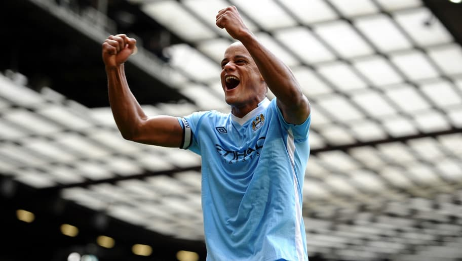 MANCHESTER, ENGLAND - OCTOBER 23:  Vincent Kompany of Manchester City celebrates his team's victory at the end of the Barclays Premier League match between Manchester United and Manchester City at Old Trafford on October 23, 2011 in Manchester, England.  (Photo by Laurence Griffiths/Getty Images)