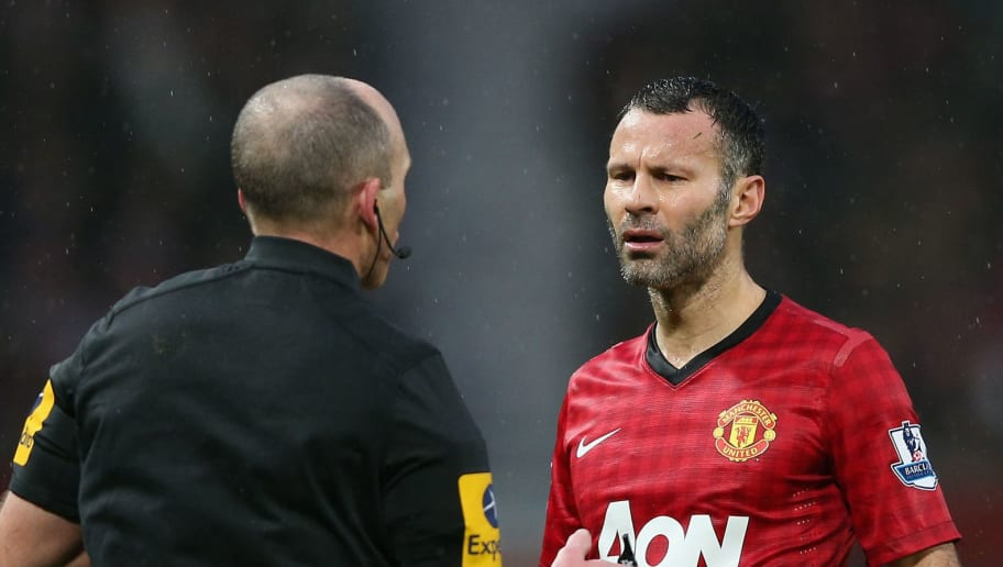 MANCHESTER, ENGLAND - DECEMBER 26: Ryan Giggs of Manchester United argues with referee Mike Dean after he allows the own goal of Jonny Evans stand during the Barclays Premier League match between Manchester United and Newcastle United at Old Trafford December 26, 2012 in Manchester, England.  (Photo by Clive Brunskill/Getty Images)