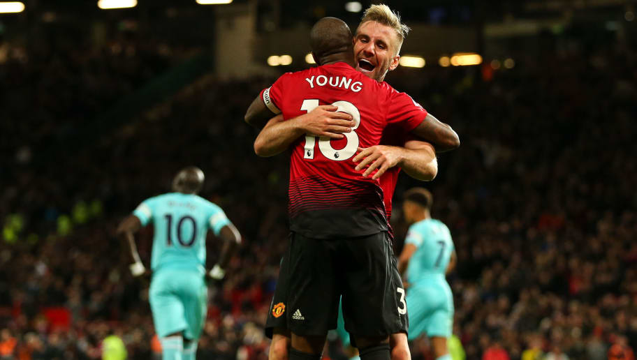 MANCHESTER, ENGLAND - OCTOBER 06: Ashley Young of Manchester United and Luke Shaw of Manchester United celebrate the third goal during the Premier League match between Manchester United and Newcastle United at Old Trafford on October 6, 2018 in Manchester, United Kingdom. (Photo by Robbie Jay Barratt - AMA/Getty Images)