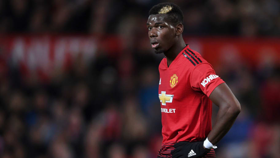 MANCHESTER, ENGLAND - OCTOBER 06:  Paul Pogba of Manchester United looks on during the Premier League match between Manchester United and Newcastle United at Old Trafford on October 6, 2018 in Manchester, United Kingdom.  (Photo by Laurence Griffiths/Getty Images)