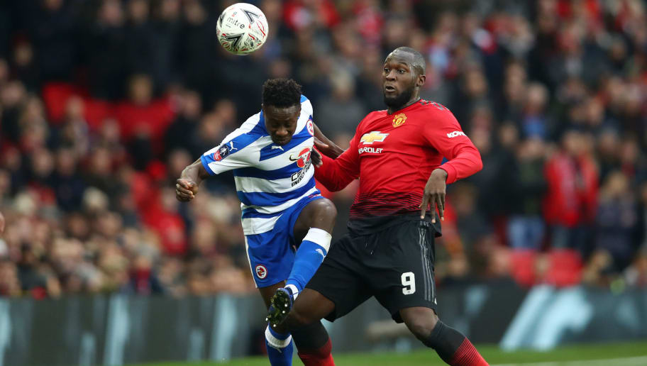 MANCHESTER, ENGLAND - JANUARY 05:  Romelu Lukaku of Manchester United battles for possession with Andy Yiadom of Reading during the FA Cup Third Round match between Manchester United and Reading at Old Trafford on January 5, 2019 in Manchester, United Kingdom.  (Photo by Clive Brunskill/Getty Images)