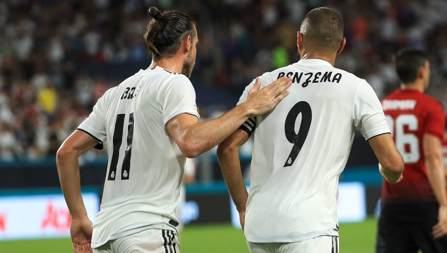 MIAMI, FL - JULY 31:  Karim Benzema #9 of Real Madrid celebrates with Gareth Bale #11 after scoring a goal against Manchester United in the first half of the International Champions Cup at Hard Rock Stadium on July 31, 2018 in Miami, Florida.  (Photo by Mike Ehrmann/International Champions Cup/Getty Images)