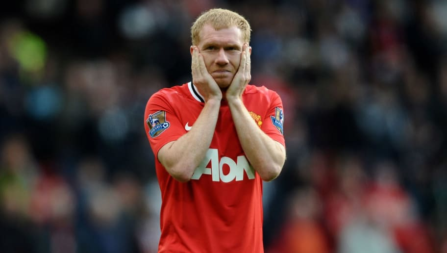 MANCHESTER, ENGLAND - MAY 06:  Paul Scholes of Manchester United looks dejected at the end of the Barclays Premier League match between Manchester United and Swansea City at Old Trafford on 6 May 2012 in Manchester, England.  (Photo by Laurence Griffiths/Getty Images)