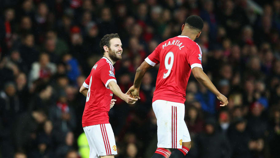 MANCHESTER, ENGLAND - JANUARY 02:  Anthony Martial (R) of Manchester United celebrates scoring his team's first goal with his team mate Juan Mata (L)  during the Barclays Premier League match between Manchester United and Swansea City at Old Trafford on January 2, 2016 in Manchester, England.  (Photo by Alex Livesey/Getty Images)