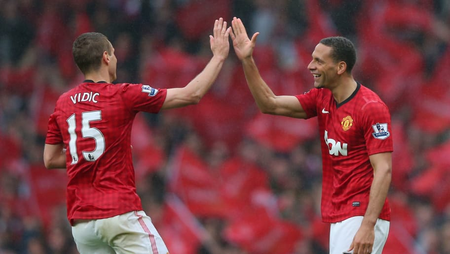 MANCHESTER, ENGLAND - MAY 12:  Rio Ferdinand of Manchester United celebrates scoring the winning goal with team-mate Nemanja Vidic during the Barclays Premier League match between Manchester United and Swansea City at Old Trafford on May 12, 2013 in Manchester, England.  (Photo by Alex Livesey/Getty Images)