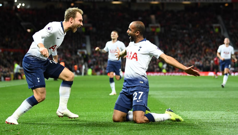 MANCHESTER, ENGLAND - AUGUST 27:  Lucas Moura of Tottenham Hotspur celebrates with team mate Christian Eriksen after scoring his team's second goal during the Premier League match between Manchester United and Tottenham Hotspur at Old Trafford on August 27, 2018 in Manchester, United Kingdom.  (Photo by Clive Mason/Getty Images)