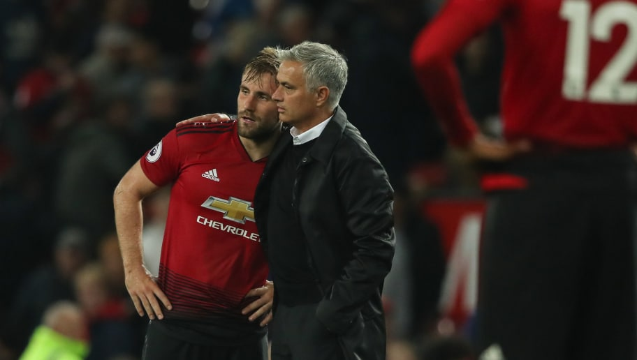 MANCHESTER, ENGLAND - AUGUST 27: Luke Shaw of Manchester United and Manchester United Manager \ Head Coach Jose Mourinho at full time during the Premier League match between Manchester United and Tottenham Hotspur at Old Trafford on August 27, 2018 in Manchester, United Kingdom. (Photo by Matthew Ashton - AMA/Getty Images)