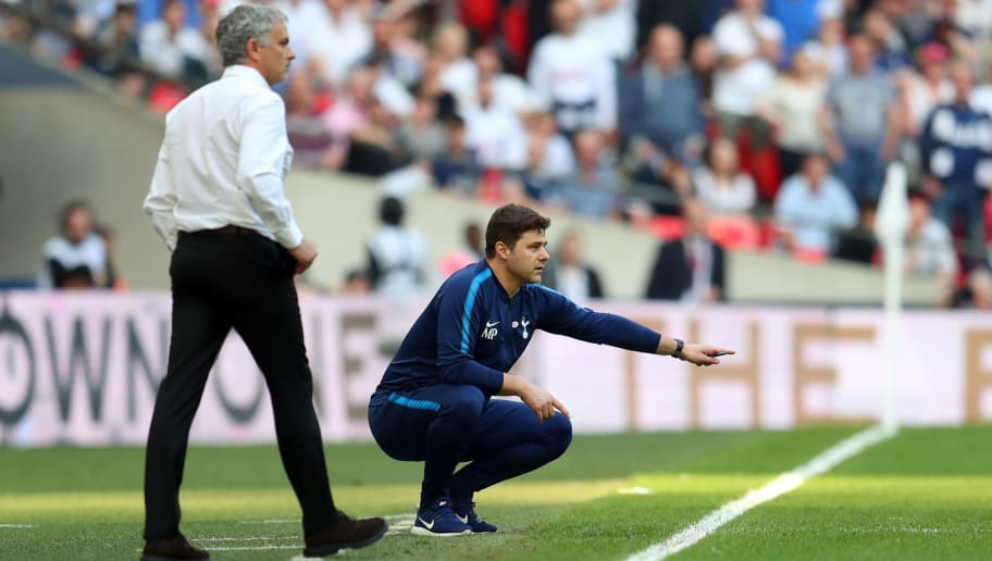 LONDON, ENGLAND - APRIL 21: Mauricio Pochettino manager / head coach of Tottenham Hotspur and Jose Mourinho the head coach / manager of Manchester United during The Emirates FA Cup Semi Final between Manchester United and Tottenham Hotspur at Wembley Stadium on April 21, 2018 in London, England. (Photo by Catherine Ivill/Getty Images)