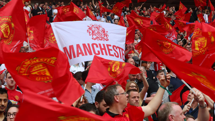 LONDON, ENGLAND - APRIL 21: Manchester United fans with flags and banners during The Emirates FA Cup Semi Final between Manchester United and Tottenham Hotspur at Wembley Stadium on April 21, 2018 in London, England. (Photo by Catherine Ivill/Getty Images)