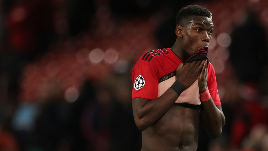 MANCHESTER, ENGLAND - OCTOBER 02: A dejected Paul Pogba of Manchester United walks off at full time during the Group H match of the UEFA Champions League between Manchester United and Valencia at Old Trafford on October 2, 2018 in Manchester, United Kingdom. (Photo by Matthew Ashton - AMA/Getty Images)