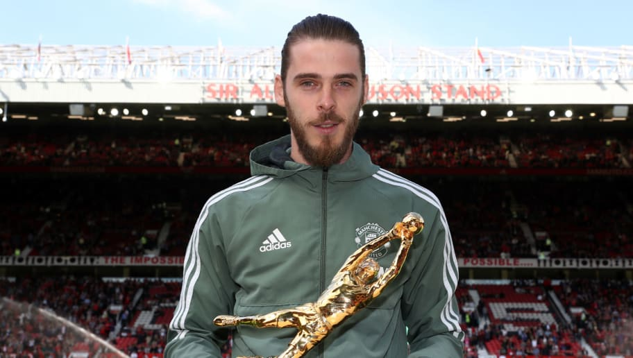 MANCHESTER, ENGLAND - MAY 13:  David De Gea of Manchester United pose for a photo with his Premier League Golden Glove Award prior to the Premier League match between Manchester United and Watford at Old Trafford on May 13, 2018 in Manchester, England.  (Photo by Matthew Lewis/Getty Images)