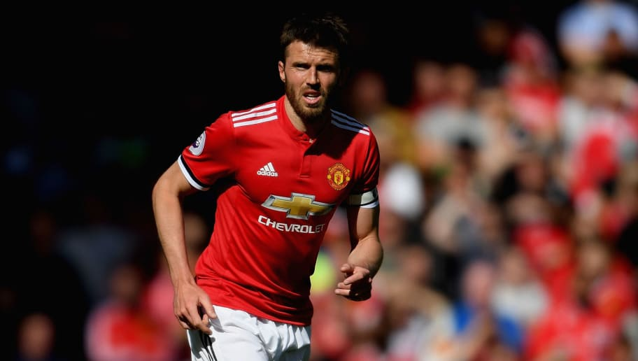 MANCHESTER, ENGLAND - MAY 13:  Michael Carrick of Manchester United in action during his final Premier League game for the club during the Premier League match between Manchester United and Watford at Old Trafford on May 13, 2018 in Manchester, England.  (Photo by Ross Kinnaird/Getty Images)