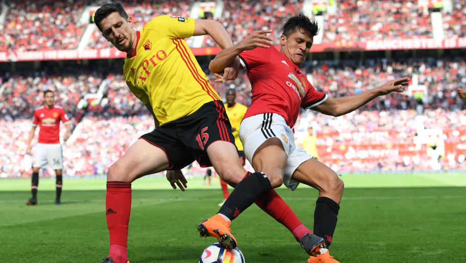 MANCHESTER, ENGLAND - MAY 13: Craig Cathcart of Watford and Alexis Sanchez of Manchester United battle for possession during the Premier League match between Manchester United and Watford at Old Trafford on May 13, 2018 in Manchester, England.  (Photo by Ross Kinnaird/Getty Images)