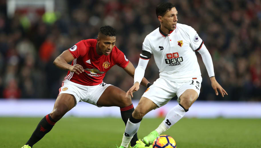 MANCHESTER, ENGLAND - FEBRUARY 11: Jose Holebas of Watford controls the ball under pressure of Antonio Valencia of Manchester United during the Premier League match between Manchester United and Watford at Old Trafford on February 11, 2017 in Manchester, England.  (Photo by Mark Thompson/Getty Images)