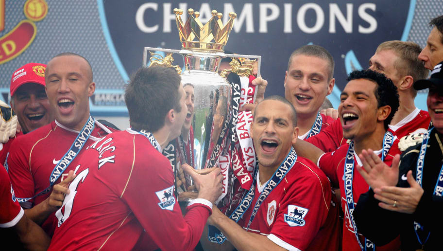 MANCHESTER, UNITED KINGDOM - MAY 13:  Michael Carrick (L) and Rio Ferdinand of Manchester United celebrate with the Premiership trophy as their team mates celebrate winning the Premiership title at the end of the Barclays Premiership match between Manchester United and West Ham United at Old Trafford on May 13, 2007 in Manchester, England.  (Photo by Alex Livesey/Getty Images)