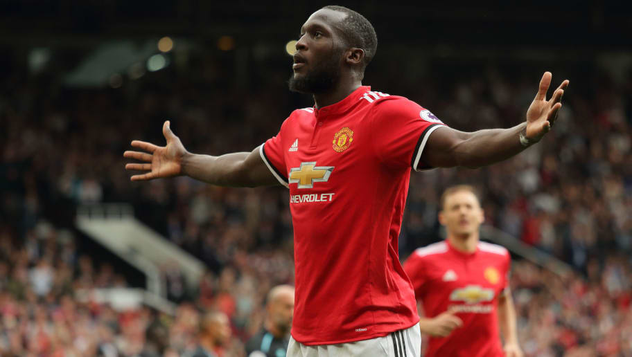 MANCHESTER, ENGLAND - AUGUST 13: Romelu Lukaku of Manchester United celebrates after scoring a goal to make it 2-0 during the Premier League match between Manchester United and West Ham United at Old Trafford on August 13, 2017 in Manchester, England. (Photo by Matthew Ashton - AMA/Getty Images)