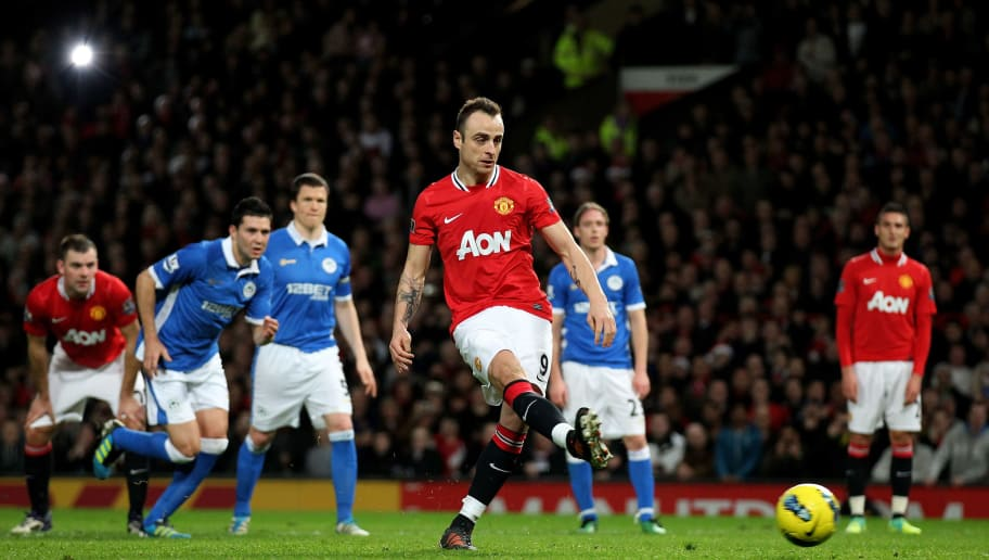 MANCHESTER, ENGLAND - DECEMBER 26:  Dimitar Berbatov of Manchester United scores his team's fifth goal, from a penalty, to complete his hat trick during the Barclays Premier League match between Manchester United and Wigan Athletic at Old Trafford on December 26, 2011 in Manchester, England.  (Photo by Alex Livesey/Getty Images)