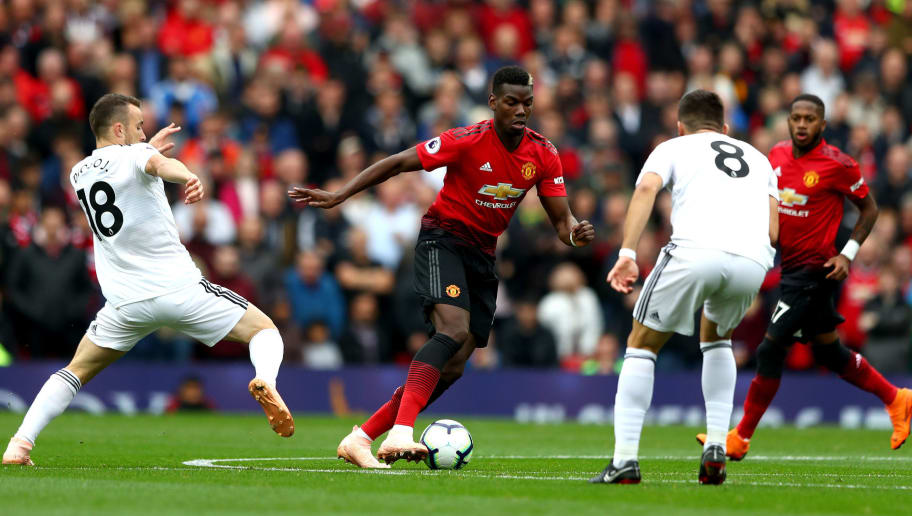 MANCHESTER, ENGLAND - SEPTEMBER 22:  Paul Pogba of Manchester United runs with the ball under pressure from Diogo Jota of Wolverhampton Wanderers during the Premier League match between Manchester United and Wolverhampton Wanderers at Old Trafford on September 22, 2018 in Manchester, United Kingdom.  (Photo by Matthew Lewis/Getty Images)